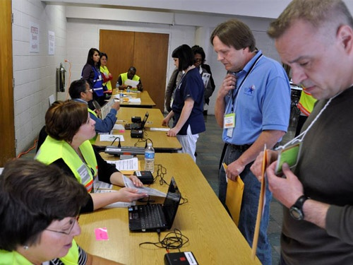 MRC Volunteers act as clients coming to pick up medication at a large dispensing exercise for the chicagoland region